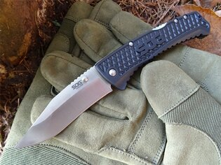Zatvárací nôž SOG® Traction - satin, čierna rukoväť